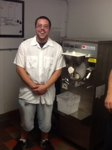 Scott stand proudly in front of his new ice cream machine