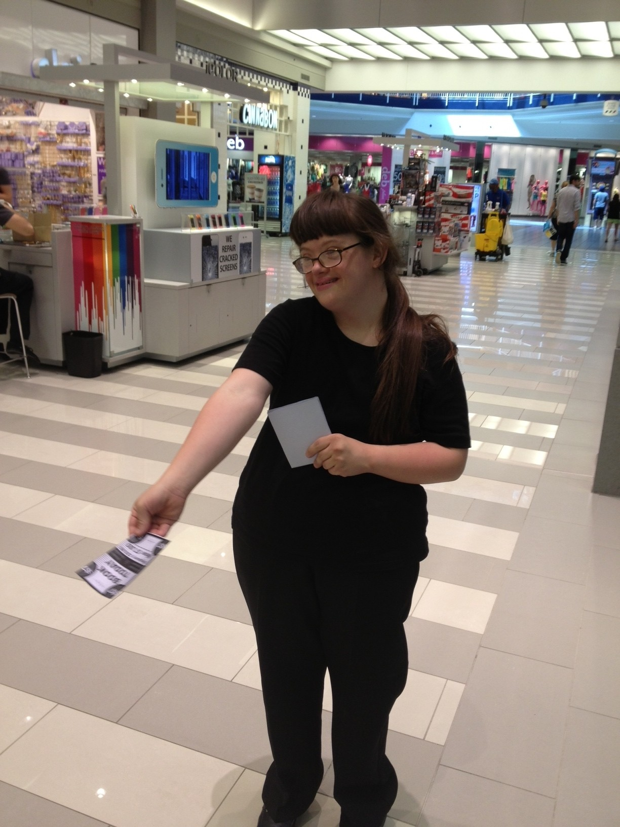 Megan handing out flyers at the Mall of America