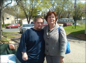 Nathan Bauer and the Mayor of Richfield Debbie Goettel showing her support   at the Richfield Historical Society community plant sale & fundraiser